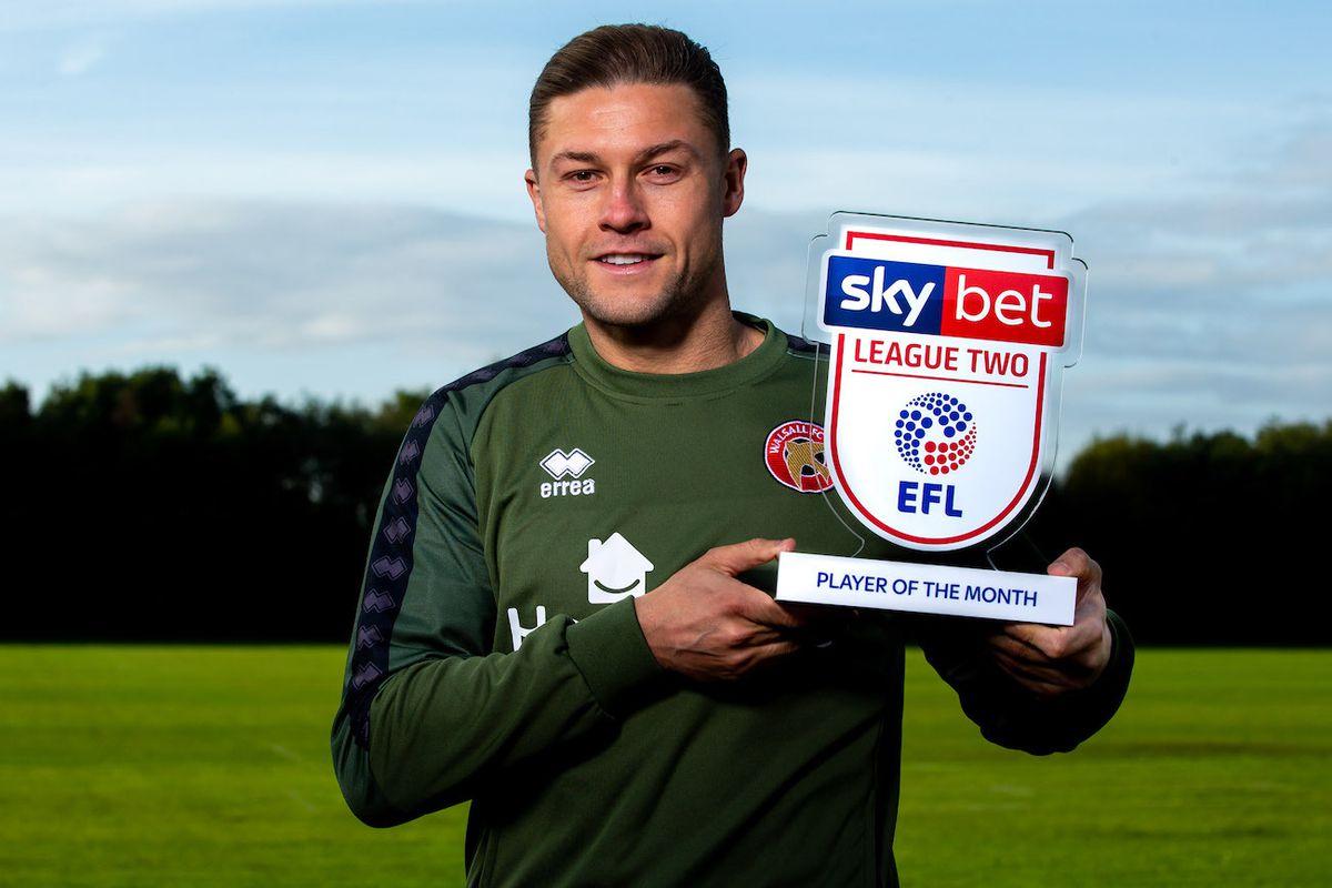 James Clarke picks up his award