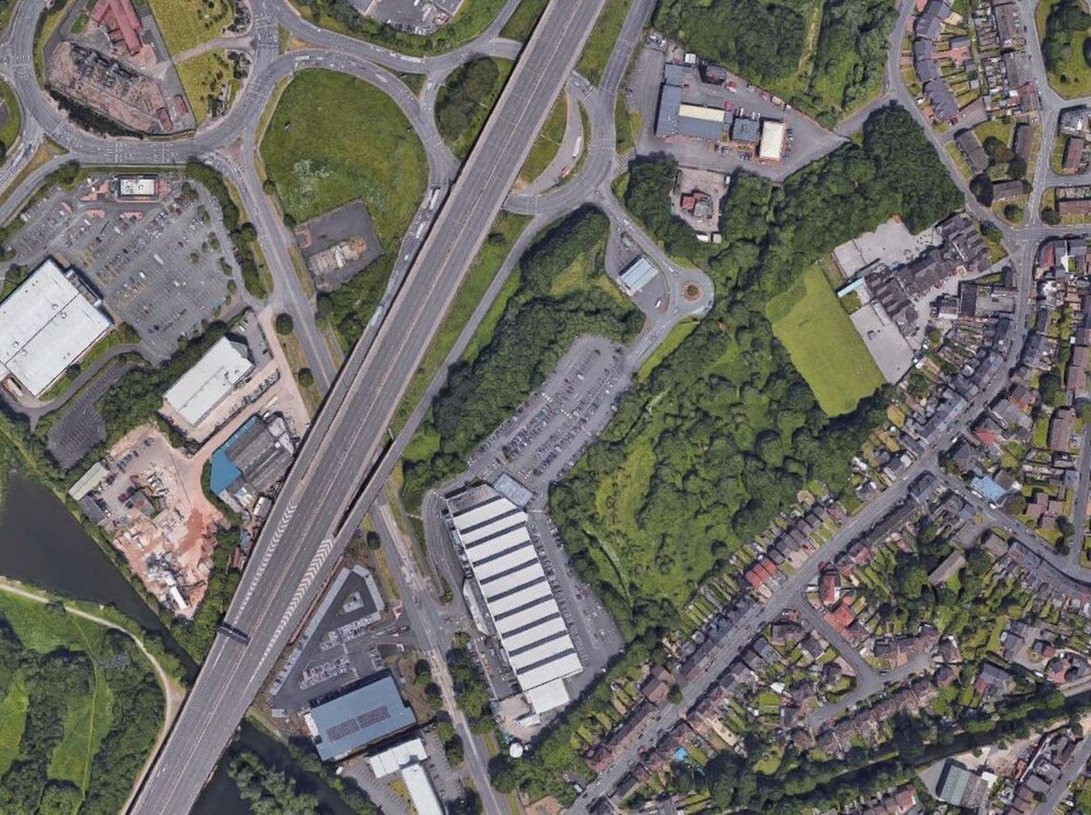 An aerial view showing the woodland where the development is proposed. Photo: Google