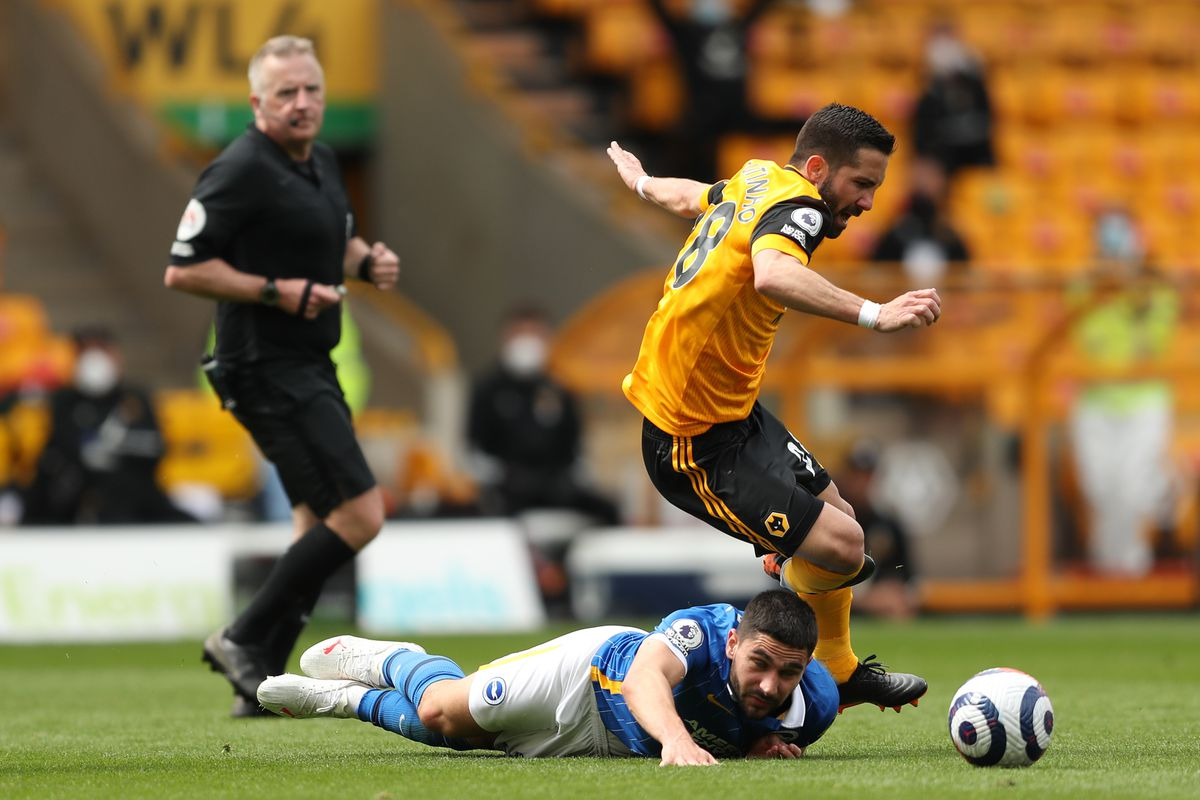 Neal Maupay of Brighton and Hove Albion and Joao Moutinho of Wolverhampton Wanderers (AMA)