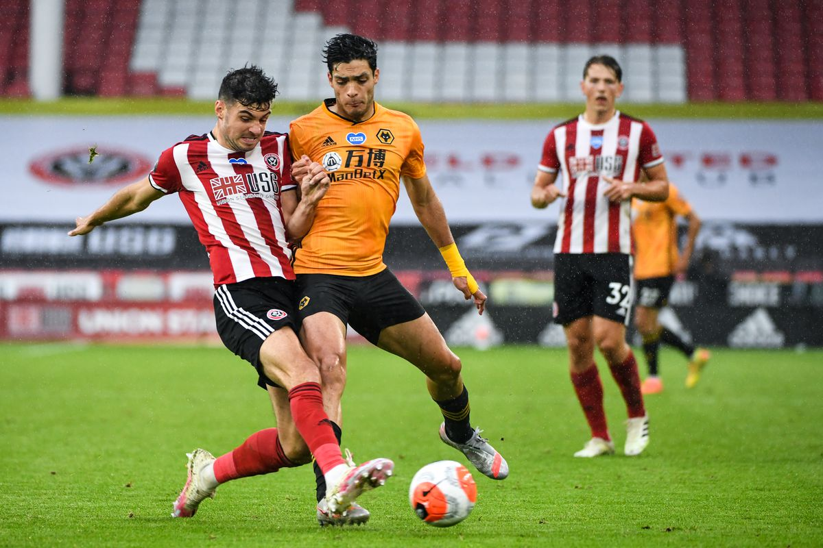 John Egan of Sheffield United and Raul Jimenez of Wolverhampton Wanderers (AMA)