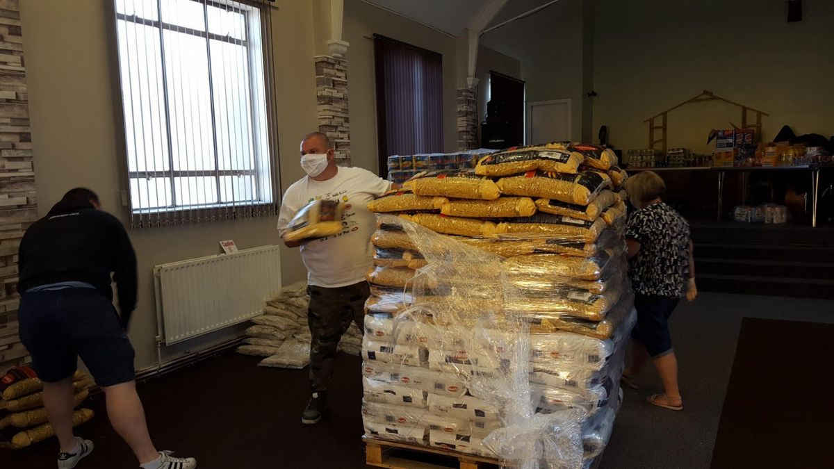 Volunteers unload food supplies at the food bank at Open Heaven Church