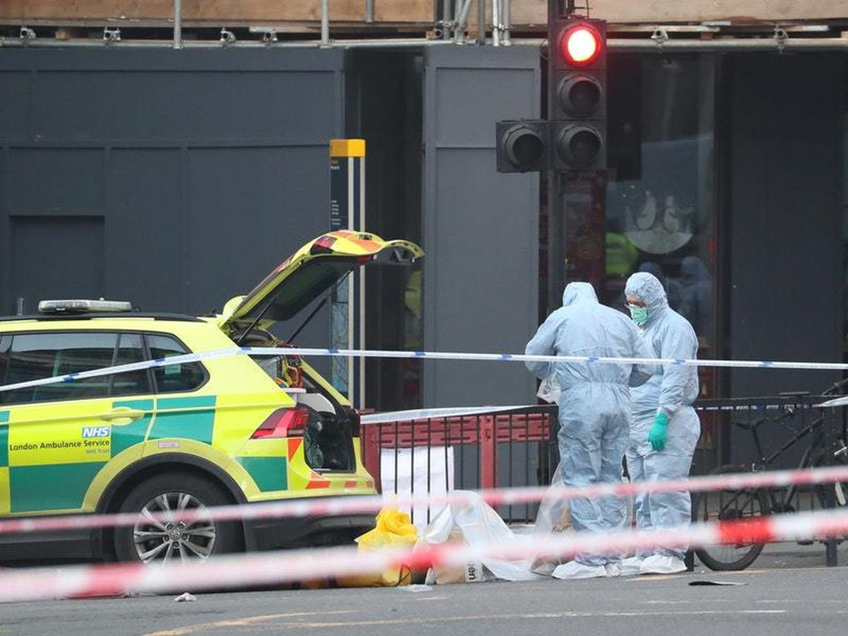 Forensic personnel at the cordoned off area around London Bridge after Friday's attack