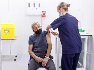 Olivia Smart, advanced practioner and Leeds Ladies FC defender, vaccinates Mewa Singh Khela, 72, with his first dose of the Oxford/AstraZeneca coronavirus vaccine