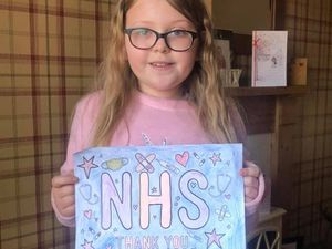 Poppy Rogers, aged 9, from Perton, near Wolverhampton, with her colourful design created to honour NHS workers and raise money