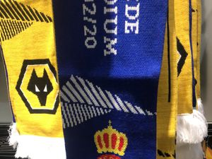 Half and half scarves have made the club shop