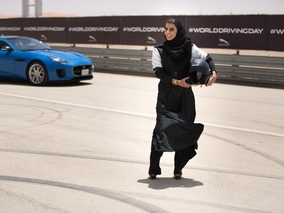 Female Saudi racing driver marks driving ban lift with lap of national circuit