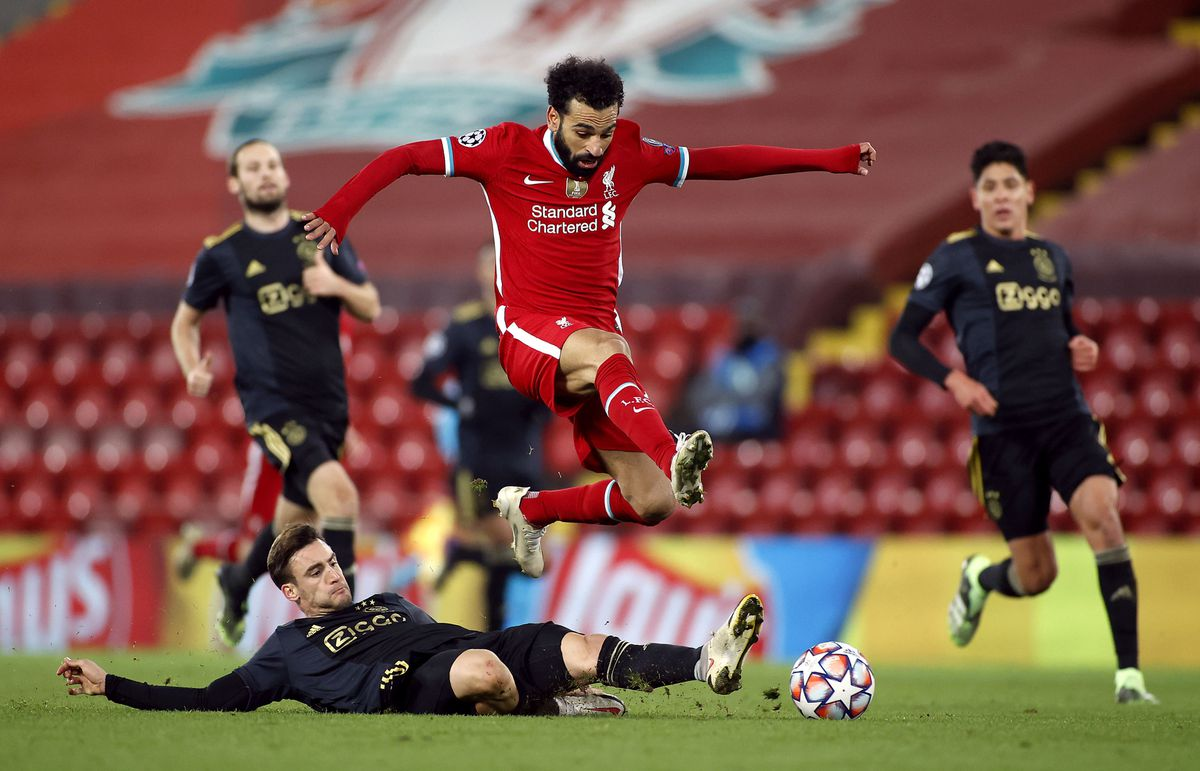 Liverpool's Mohamed Salah jumps the tackle from Ajax   s Nicolas Tagliafico during the UEFA Champions League Group D match at Anfield, Liverpool. PA Photo. Picture date: Tuesday December 1, 2020. See PA story SOCCER Liverpool. Photo credit should read: Phil Noble/PA Wire. RESTRICTIONS: Editorial use only, no commercial use without prior consent from rights holder.
