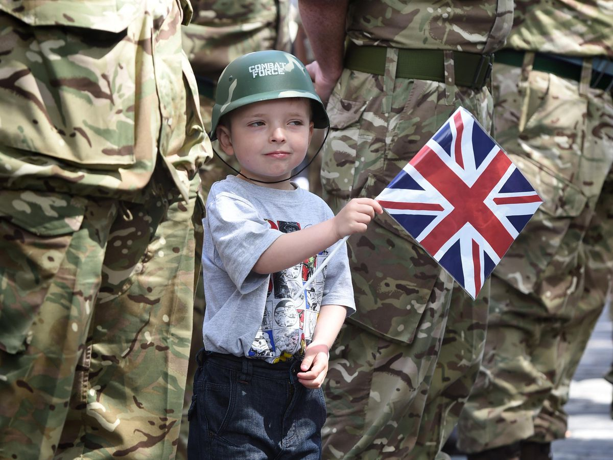 A child waves a union flag on a previous Armed Force Day in Edinburgh