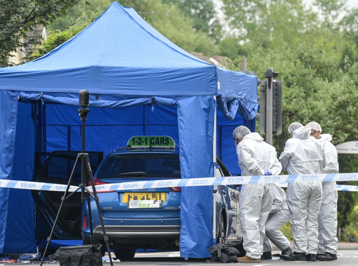 A forensics tent was put up over a taxi from 121 Taxis, based in Tipton. Photo: SnapperSK.