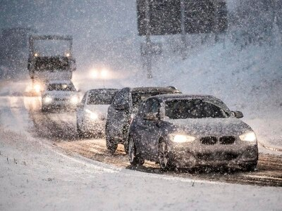 Parts of UK blanketed in snow as flood warnings continue