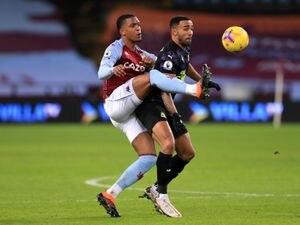 Aston Villa's Ezri Konsa (left) and Newcastle United's Callum Wilson