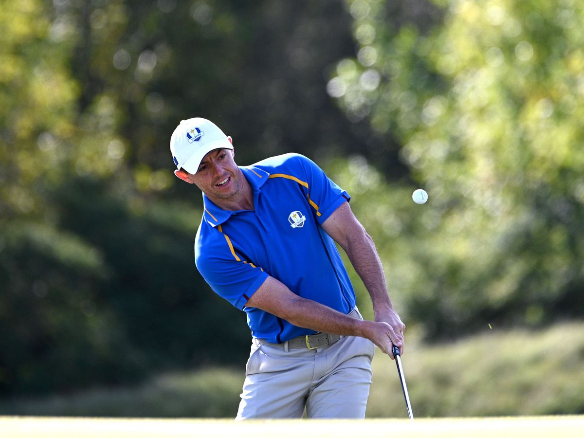 Rory McIlroy watches his tee shot