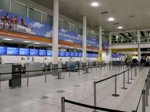 Empty Thomas Cook check-in desks at Gatwick Airport