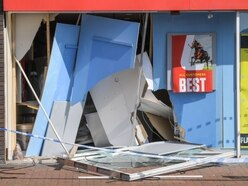 Man's leg broken as car smashes into Ladbrokes shop