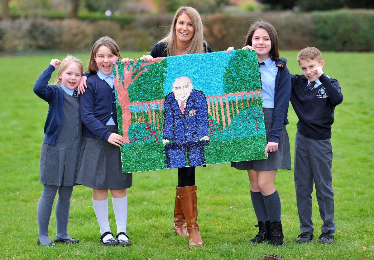Teacher Charlotte Priest with some of the children at Palmers Cross Primary School who created a large picture of Sir Tom Moore