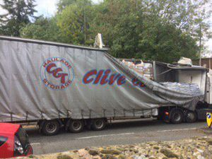 The lorry hit the bridge in Compton this afternoon. Photo by @epz700