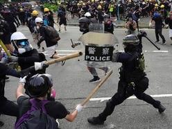 Hong Kong police fire tear gas at demonstrators amid chaotic scenes