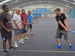 Bobby Christopher, Gordon Oates, Zara Younis, Kevin Cheung are being put their paces by tennis coach Andy Griffin at Tipton Sports Academy