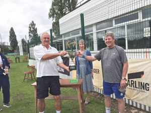 Peter Wilson and Peter Sutton celebrate winning the Peter Baker Memorial Cup after being presented with the cup by Peter Baker's widow Chris