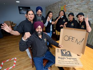 Veggie Supreme Pizza owners Harminder Singh and Anup Kaur celebrate reopening inside with staff