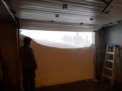 Canadians open garage door on record-breaking snowfall as emergency called