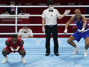 Ben Whittaker, right, reacts with delight after beating Kena Machado of Brazil on points