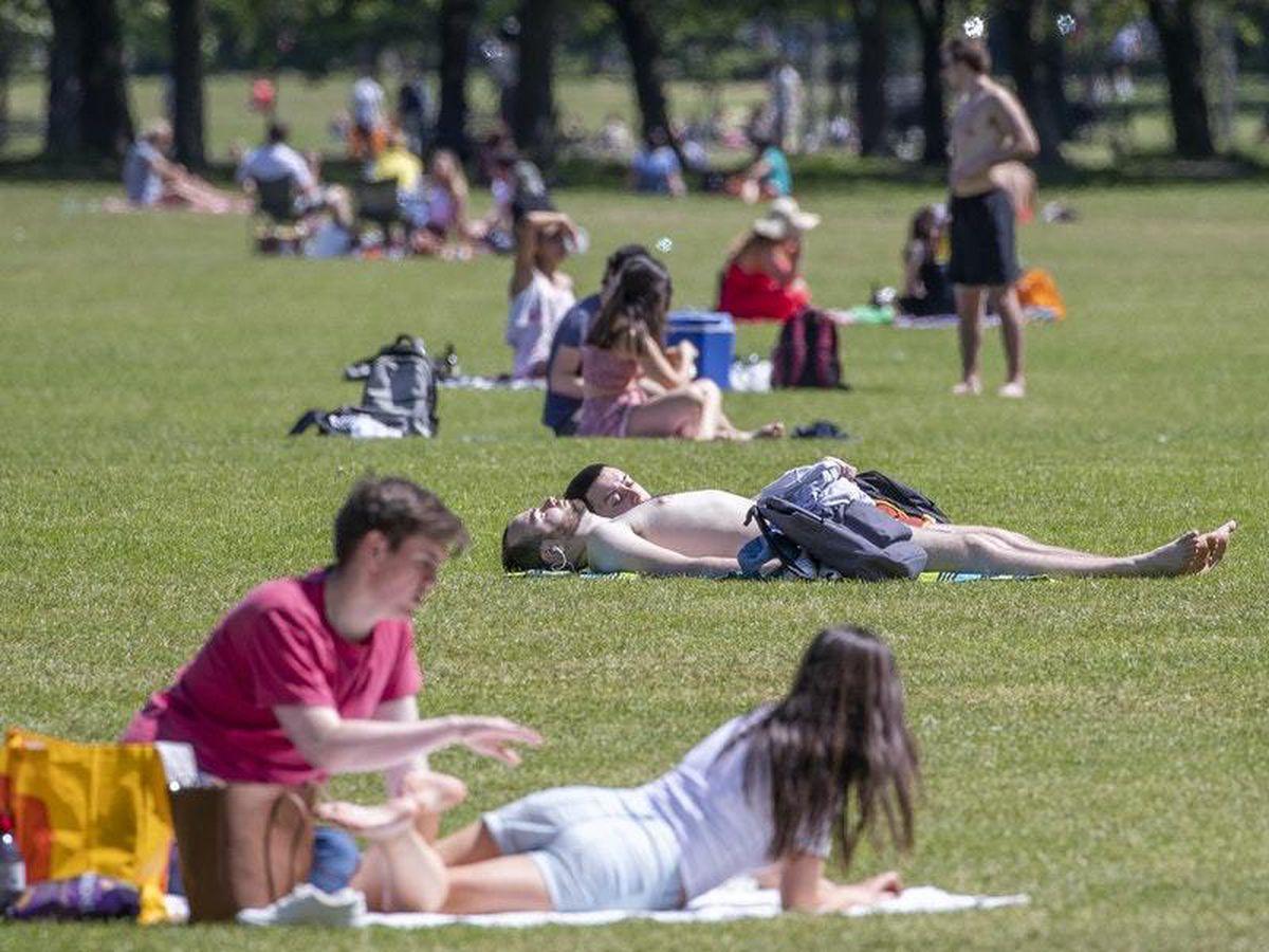 People sunbathe and exercise
