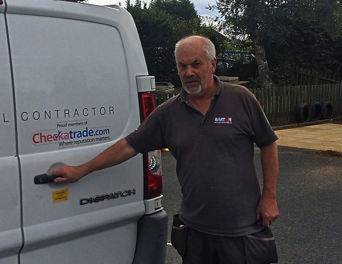 Ray Taylor with his van which has a yellow sticker on the back warning potential thieves that a shock is in store