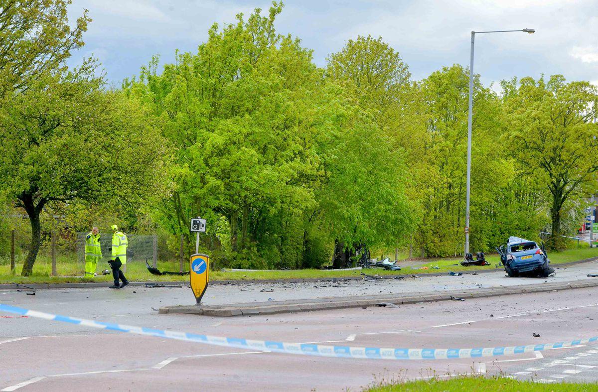 Collision investigators examine the scene