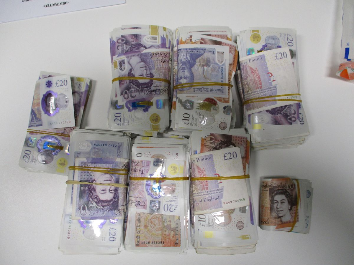 Some of the cash recovered from the vehicles by police