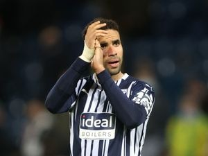 """West Bromwich Albion's Hal Robson-Kanu reacts after the final whistle during the Premier League match at The Hawthorns, West Bromwich. Picture date: Wednesday May 19, 2021. PA Photo. See PA story SOCCER West Brom. Photo credit should read: Molly Darlington/PA Wire...RESTRICTIONS: EDITORIAL USE ONLY No use with unauthorised audio, video, data, fixture lists, club/league logos or """"live"""" services. Online in-match use limited to 120 images, no video emulation. No use in betting, games or single club/league/player publications.."""