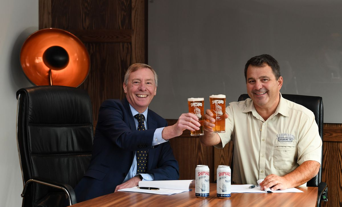Richard Westwood, MD of Marston's Beer Co, signing the contract at Marston's House with Fred Forsley, Shipyard co-founder