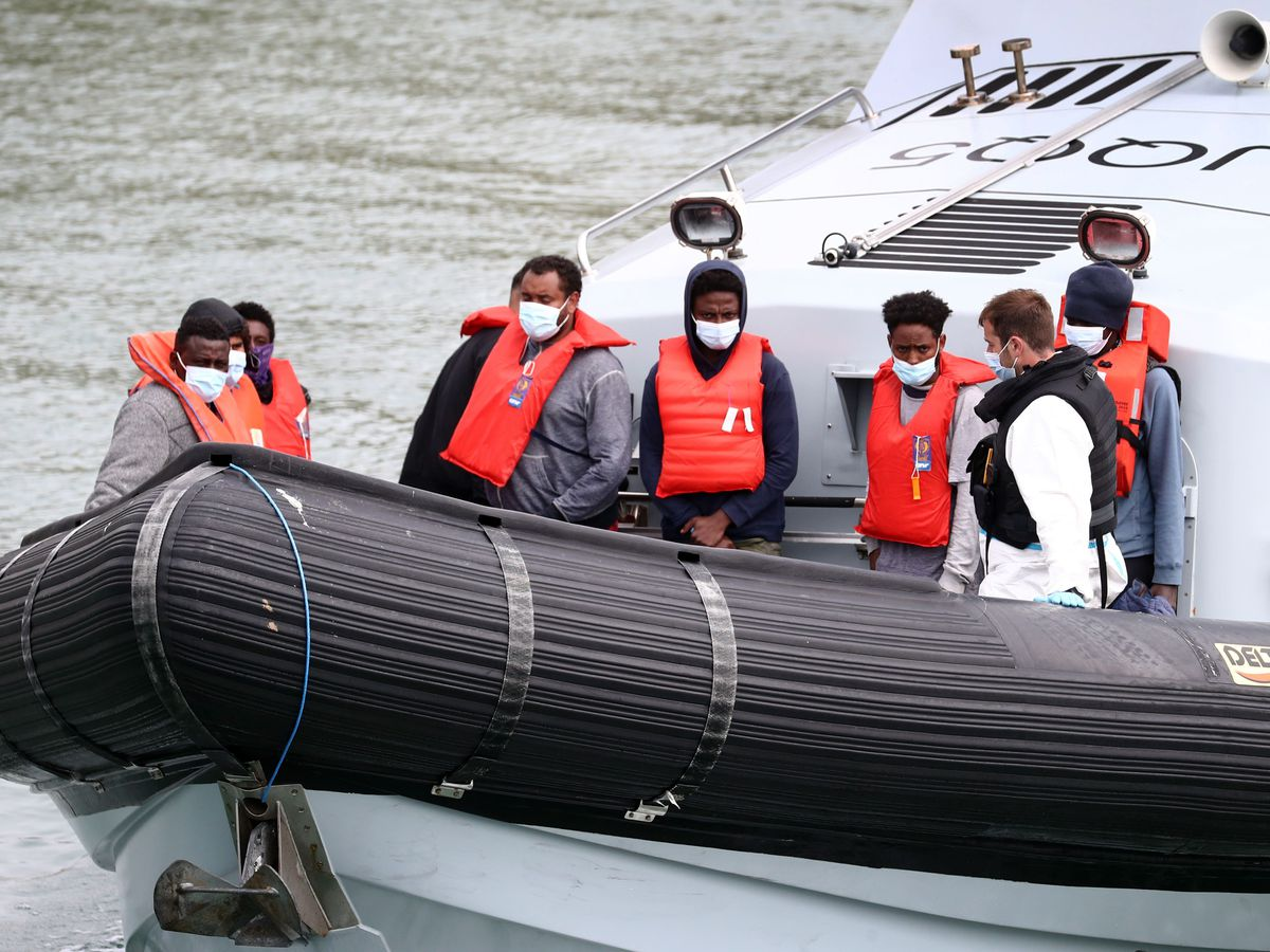 Migrants, including children, are brought in to Dover following a small boat incident in the Channel this week