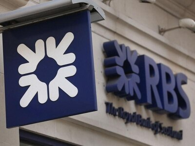 Royal Bank of Scotland swings to first profit in a decade