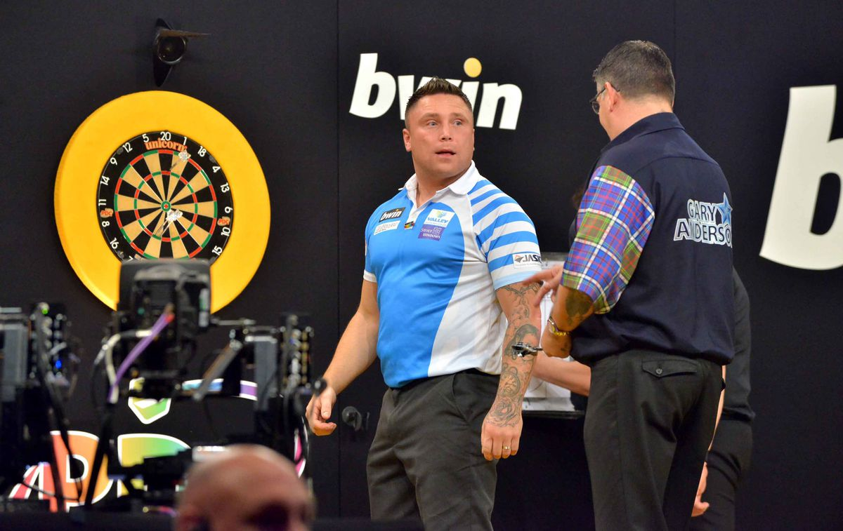 Gerwyn Price (in light blue, overall winner) and Gary Anderson (Dark top)