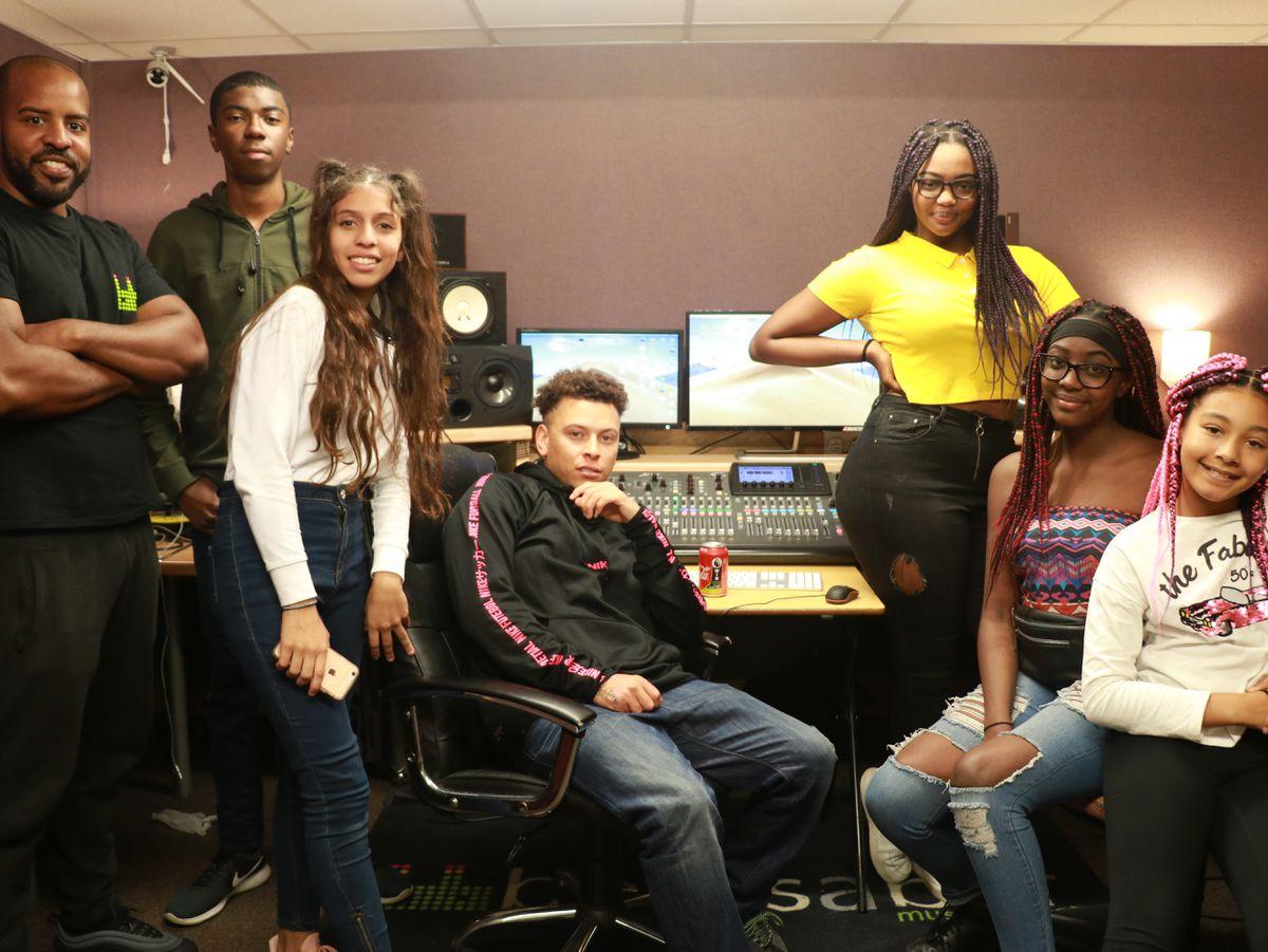 John Paul, far left, and some of those benefitting from using Beatsabar Studios