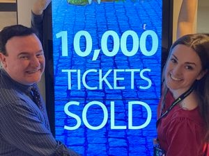 Front of house manager Gary Stevens and marketing assistant Jessica Horton celebrate10,000 Snow White sales