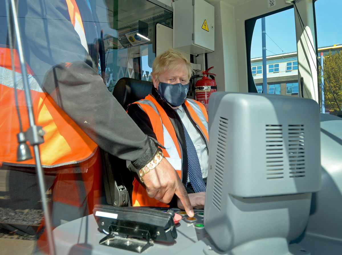 Boris Johnson takes control of one of the trams as he visits Midland Metro's Wednesbury depot