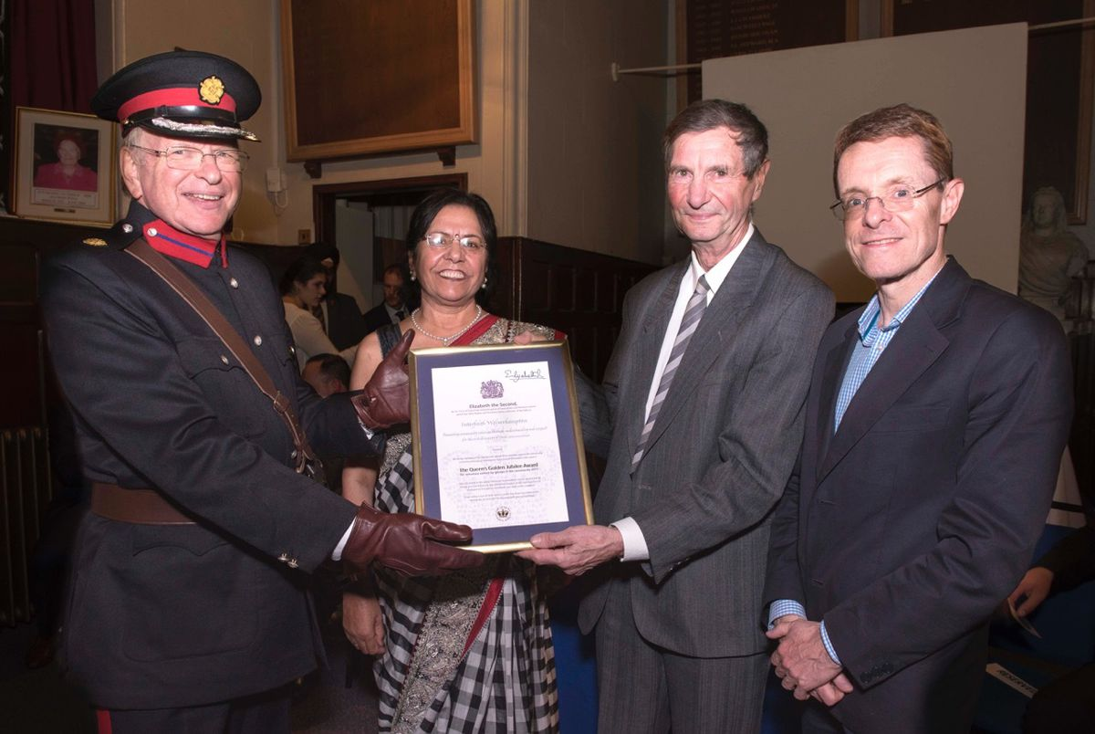 The award presented by Deputy Lord Lieutenant Clive Stone, with chairwoman of Interfaith Wolverhampton Parveen Brigue and ex-secretary Erik Pearse, with West Midlands Mayor Andy Street