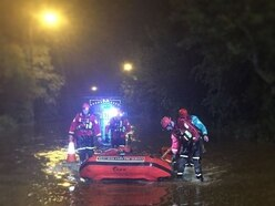 Man dies after van submerged in water in flood tragedy