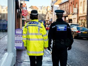 Police Officer and Police Community Support Officer walk the streets
