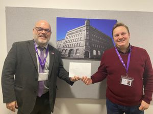 John Coyne presents Ashley Ratcliff with £250 worth of gift vouchers after he was voted employee of the year