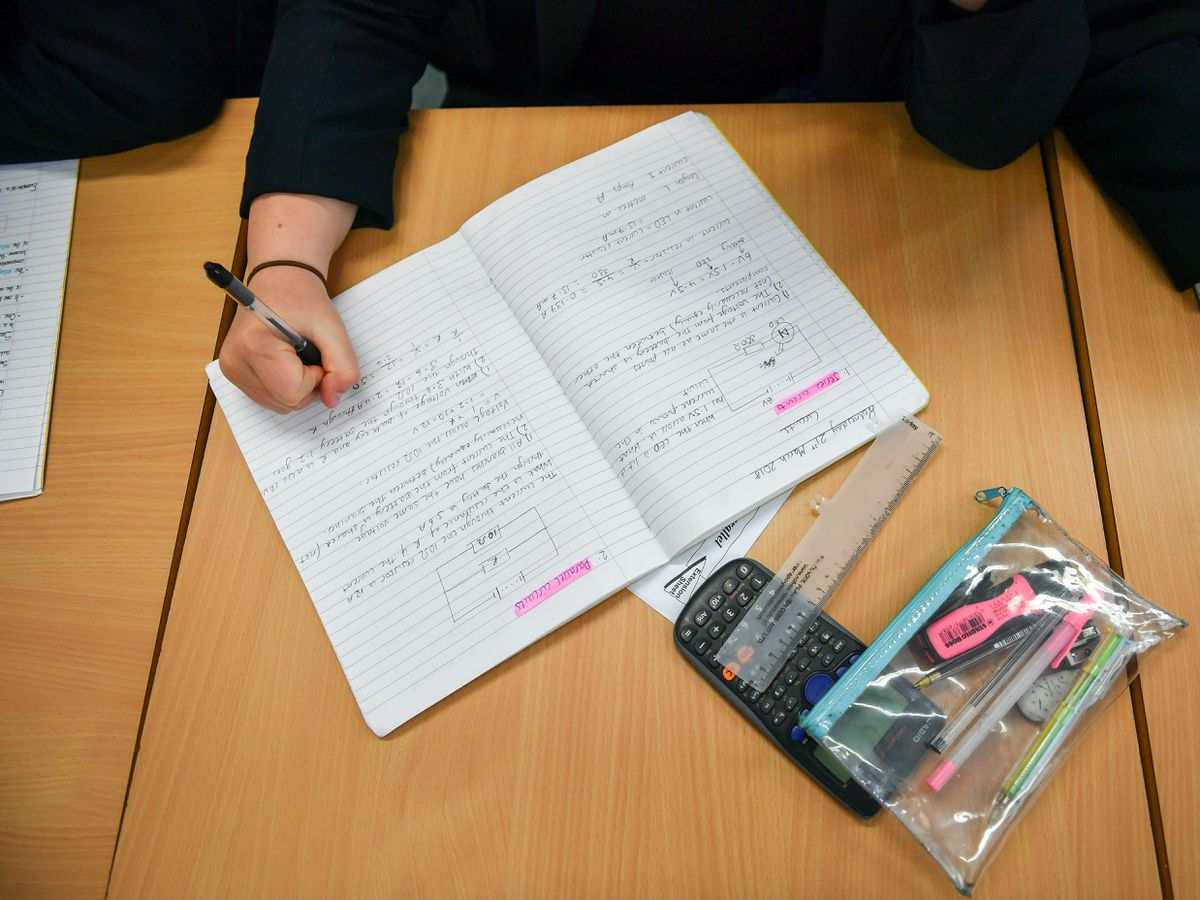 Students write in their exercise books