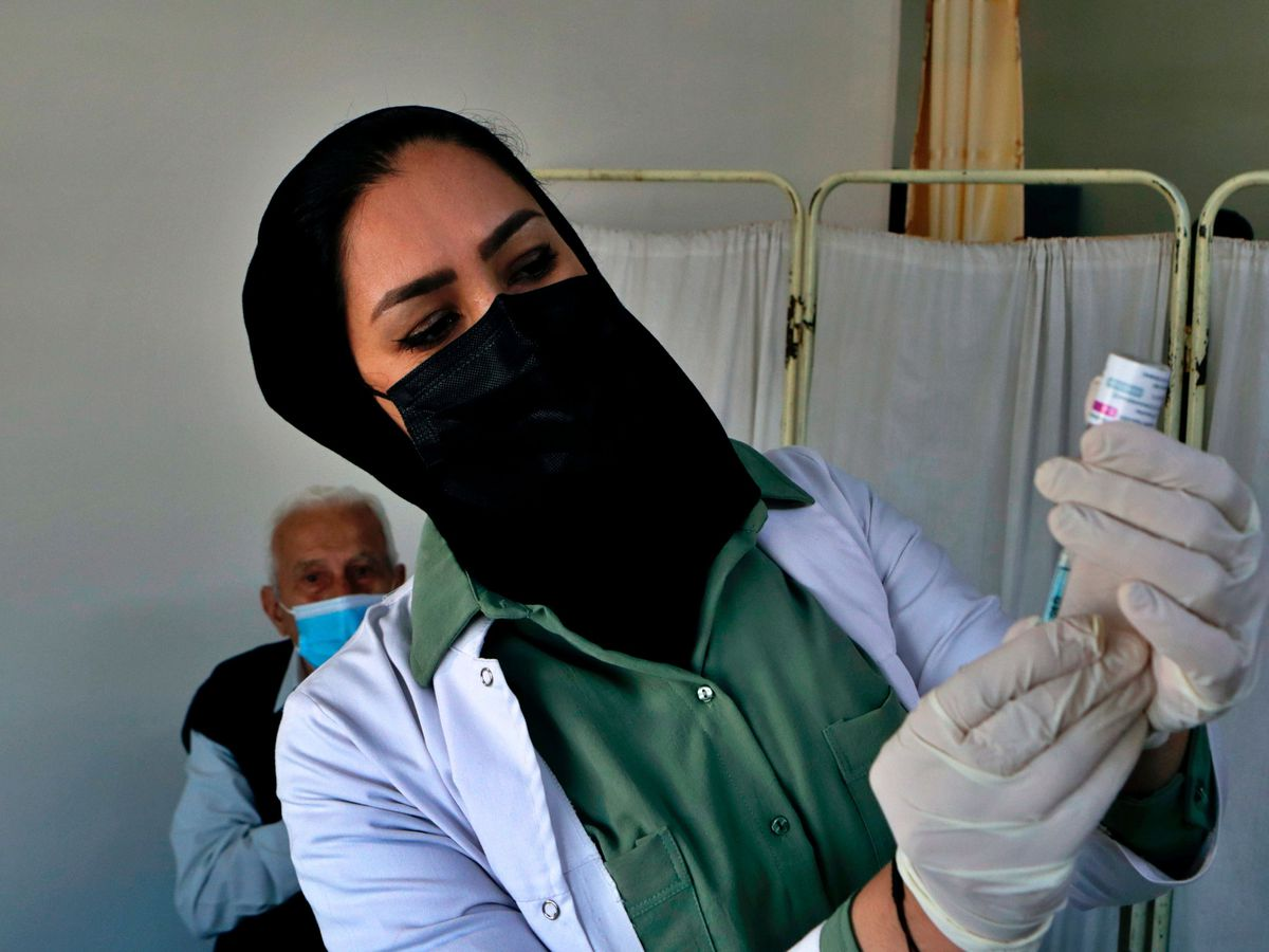 An Iraqi nurse prepares a jab of the AstraZeneca vaccine (Khalid Mohammed/AP)