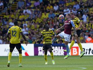 """Watford's Peter Etebo (2nd left), Aston Villa's Danny Ings and Watford's Dan Gosling (right) in action during the Premier League match at Vicarage Road, Watford. Picture date: Saturday August 14, 2021. PA Photo. See PA story SOCCER Watford. Photo credit should read: Jonathan Brady/PA Wire...RESTRICTIONS: EDITORIAL USE ONLY No use with unauthorised audio, video, data, fixture lists, club/league logos or """"live"""" services. Online in-match use limited to 120 images, no video emulation. No use in betting, games or single club/league/player publications.."""