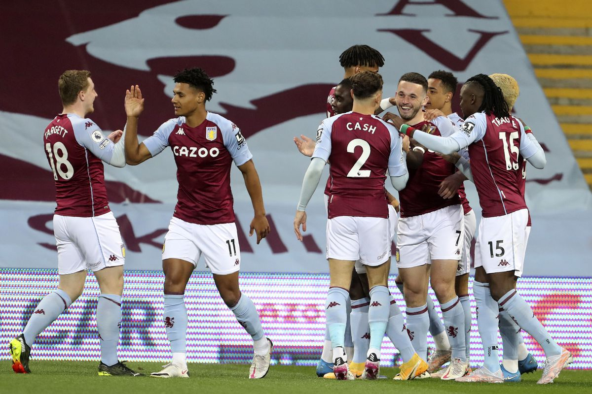 Aston Villa's John McGinn (fourth right) celebrates