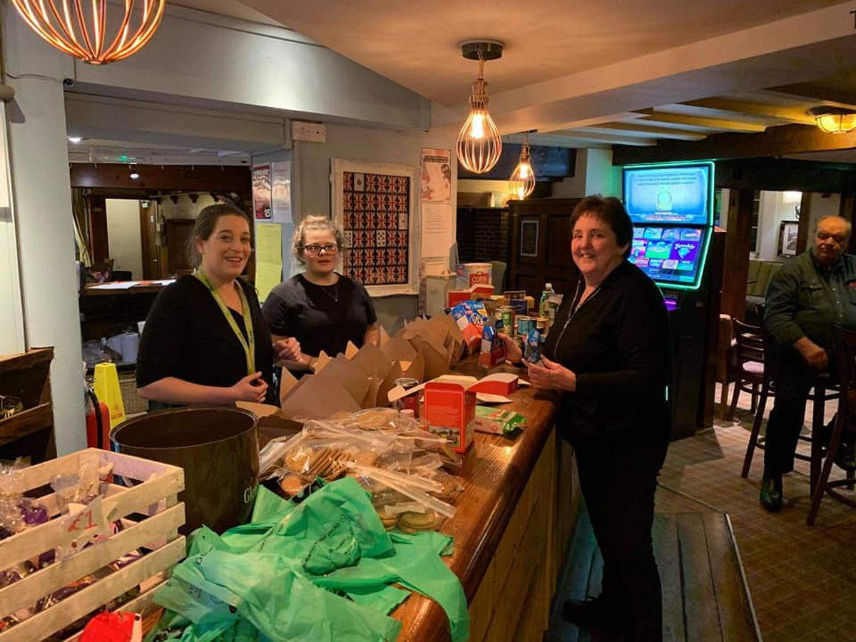 Staff at The Crown in Albrighton boxing up donations