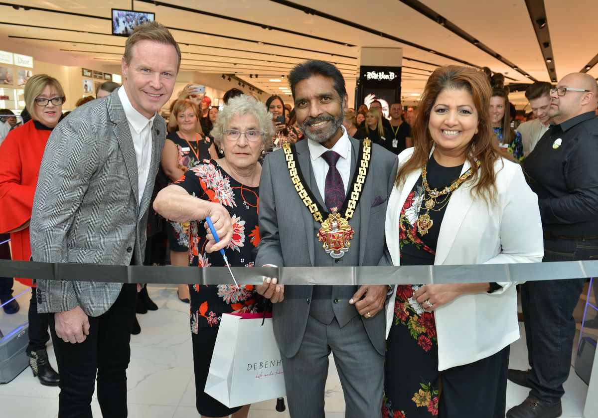 Local hero Ann Guest pictured with the Mayor of Wolverhampton, Councillor Elias Mattu and Mayoress Asha Mattu and former Wolves Star Jody Craddock as they officially open the brand new Debenhams store