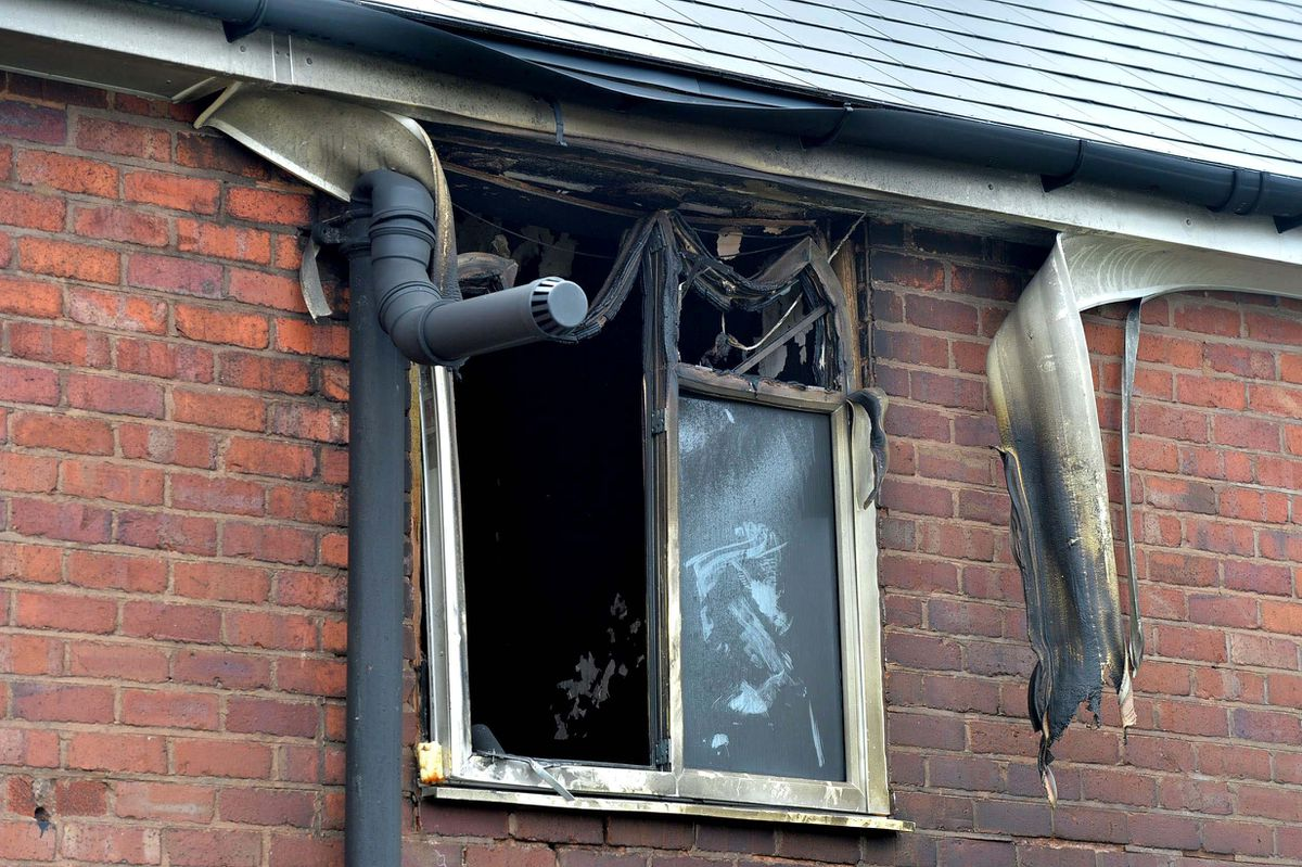 Fire damage in a first-floor window. Witnesses said the fire consumed the whole house