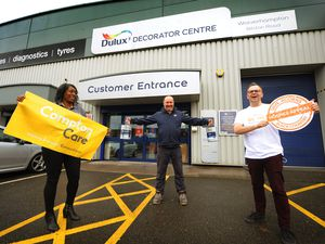 Making donations of paint (centre) store manager Rod Vaughan, to (left) Compton Care corporate fundraiser Elaine Reed, and (right) Acorns Hospice volunteer manager Toby Mobberley, at Dulux Decorator Centre, Wolverhampton